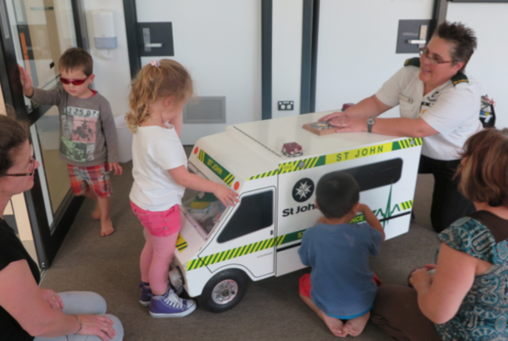 A photo of the children and the mini ambulance
